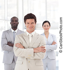 Business man smiling in front of Business team - Young...