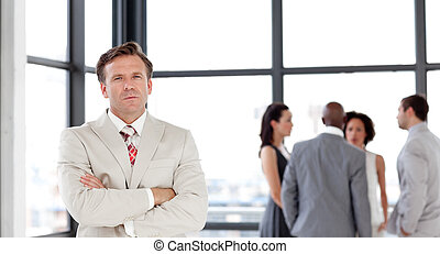 Senior Businessman standing in Front of Business team -...