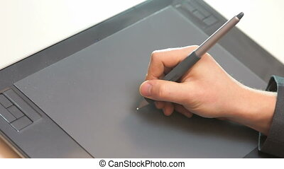 Hand drawing on tablet - A man hand drawing on graphic...