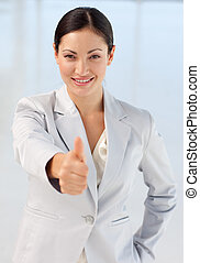 Confident and attractive busineswoman being positive with...