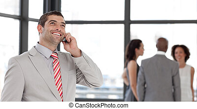 Businessman on the phone in front of business team