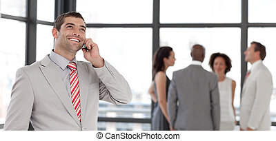 Businessman on the phone in front of business team - Potrait...