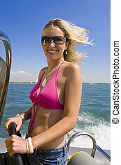 Fast Fun At Sea - A beautiful young woman driving her...