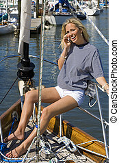 Communication On Deck - A stunningly beautiful young blond...