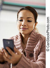 asian girl reading sms on smarthphone