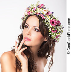 Young Beauty Womans Face with Bouquet of Natural Flowers