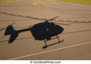 Silhouette of helicopter landing - Silhouette of BK117 /...