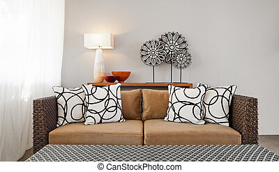 Beige brown sofa in interior setting - Beige brown sofa in...