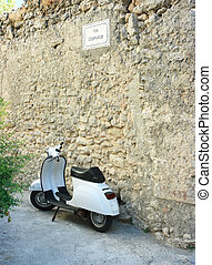 Vespa in via Leopardi near ancient rustic wall