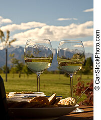 Snowy Mountains Seen Through Wine Glasses - Snowy mountains...
