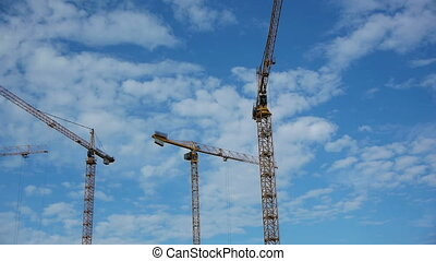 Timelapse: Three hoisting cranes - Timelapse: Three hoisting...