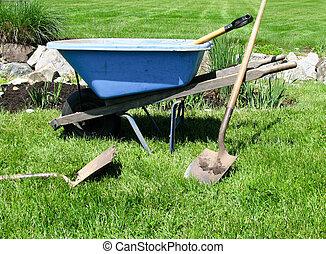 Blue wheelbarrow, gardening tools