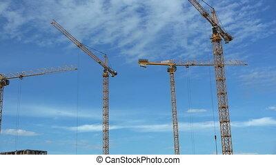 Timelapse: Hoisting cranes - Timelapse: Hoisting crane at a...