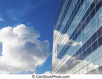 glass office building - sky reflected in a modern office...