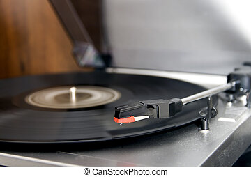 Turntable - Closeup of a turntable playing a vinyl record
