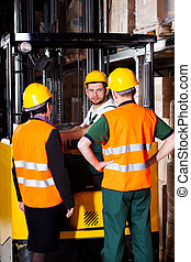 Forklift worker with management - Pair of managers talking...