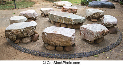 Big stone Garden Table and nine chairs.