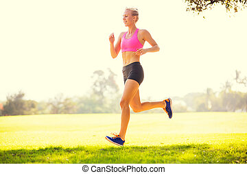 Woman running in the park - Attractive young woman jogging...