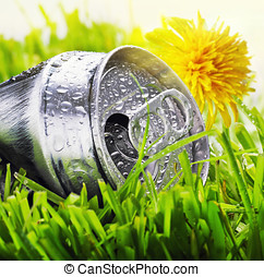 aluminum can on a green grass - crumpled aluminum can on a...