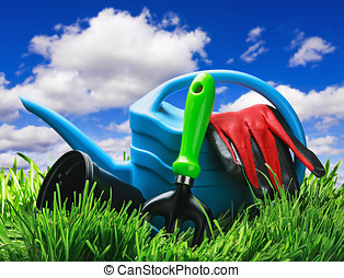 garden tools on a lawn