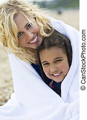 Keeping Warm At The Beach - A beautiful blond haired blue...