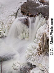 Frozen Waterfall from Above - A creek flows over the rock...