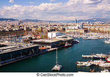 Aerial view of Port Vell and Barcelona city in cloudy...