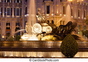 The Cibeles Fountain at Plaza de Cibeles in summer evening...