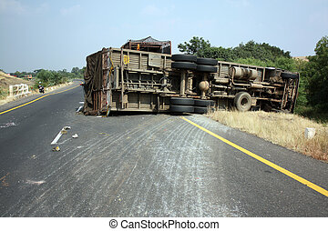 Overturned Truck - A view of an overturned truck on an...