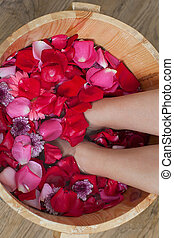 Foot bath with flowers in spa salon - Foot bath with flowers...