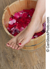 Foot bath with flowers in spa salon, indoors Photo taken on:...