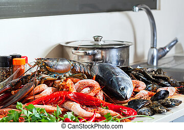 Fresh lobster and other seafood  in  kitchen