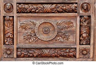 Wood-carving with floral elements
