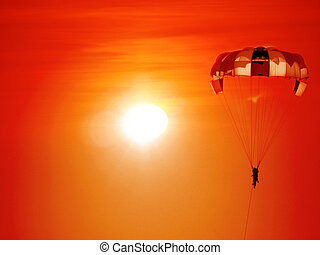 Sunset Paragliding - A beautiful background of a parasailing...