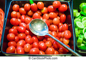 Tomatoes presented on salad bar, Fresh tomato