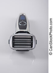 Ultramodern Five Blades Electric Shaver On Smooth Reflecting...