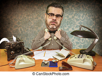 Saturated office worker oppresses two phones against the...
