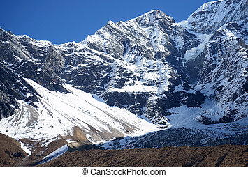 High rocky mountains, snow-capped peaks High rocky...
