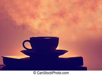 Morning coffee cup and book with bokeh background