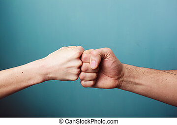 Fist bump - Young man and woman are fist bumping