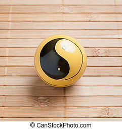 One baoding ball on bamboo background in square composition