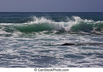 Cresting Wave - Ocean wave cresting at a beach in Dana...