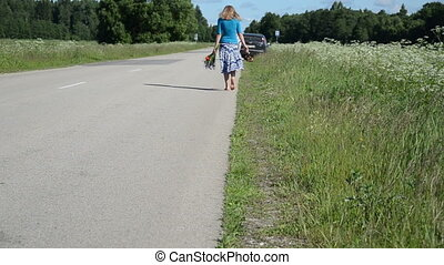 barefoot woman road - Barefoot girl with conflowers and...