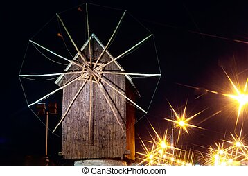 windmill by the sea at night in Nessebar, Bulgaria