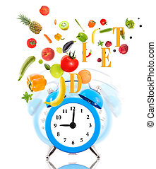 Diet concept with clock ringing, fruits and vegetables.