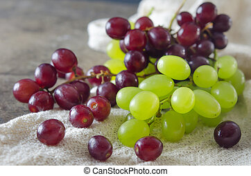 red and green grapes - red and green grape in wooden basket...