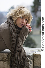 Attractive blonde young woman outdoors in winter -...