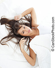 Beauty in Bed - Portrait of beautiful woman in white bed
