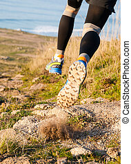 Man practicing trail running and leaping outdoors