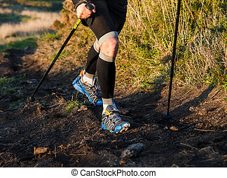 Detail of a man practicing trail running